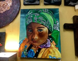 Closeup painting of little girl wearing traditional Mexican clothing