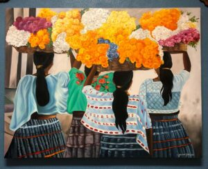 Painting of Mexican women holding baskets of flowers above their heads, in Cabo San Lucas
