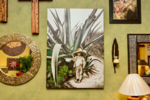 Painting of young Mexican boy next to a agave cactus, available in Cabo San Lucas, Mexico