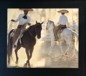 Bruce Herman photograph of Mexican cowboys riding horses
