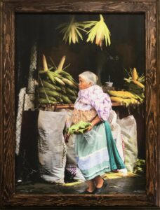 Bruce Herman photograph of elderly Mexican woman at corn stall