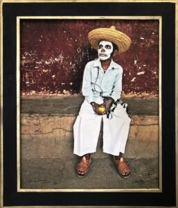 Bruce Herman photograph of Mexican man wearing skull makeup and a hat