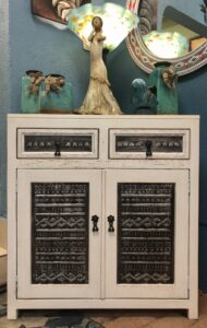 White wormwood dresser with decorative aluminum panels, two drawers, and two doors