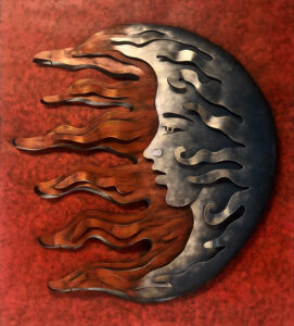 Rustic red metal wall art  of a moon and a sun