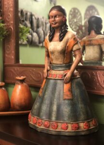 Ceramic sculpture of woman wearing traditional Mexican clothing
