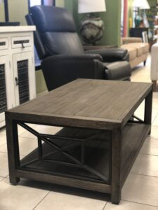 Wooden rectangular coffee table with metal details at furniture store in Cabo San Lucas