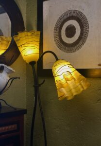 Iron floor lamp with yellow blown glass shades in Cabo San Lucas