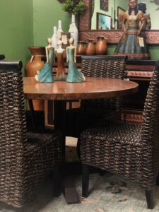 Round hammered copper table with wicker chairs