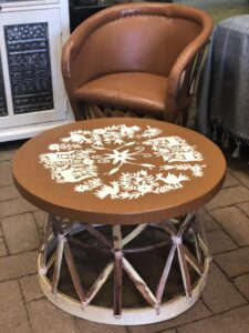Caramel-color equipal table with handpainted white details