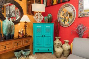 Turquoise Mexican wormwood cabinet with carved details and metal handles