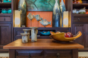 Wooden coffee table and buffet with clay sculptures, for sale in Cabo San Lucas