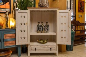 White wormwood cabinet with carved details, two shelves, and a drawer