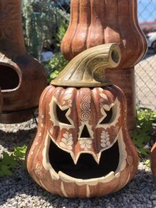 Halloween Jack-o-lantern outdoor clay decoration with handprinted details and a lid