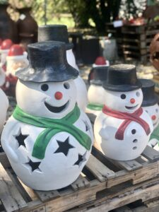 Festive holiday clay garden decorations