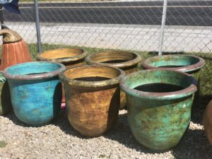 Authentic Mexican handcrafted outdoor pots in blue, brown, and teal
