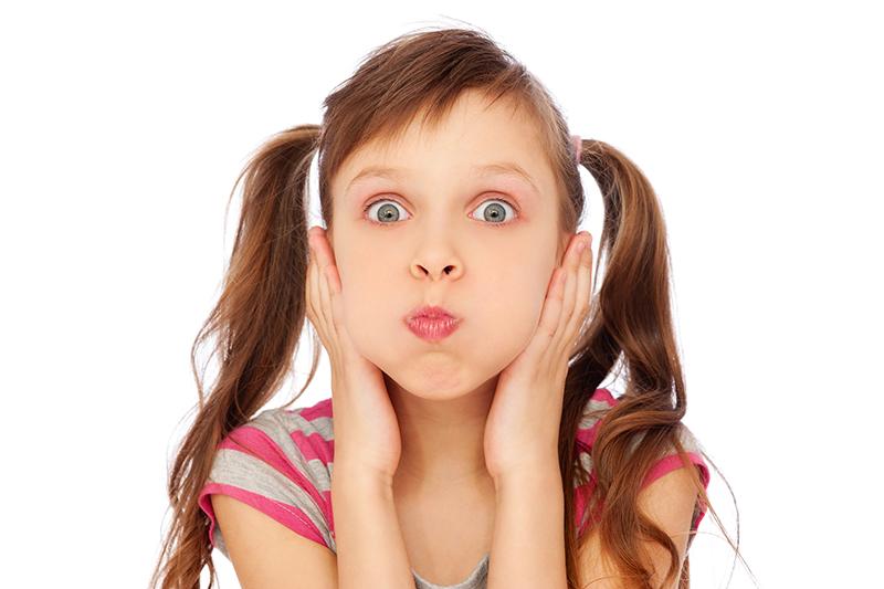 girl making faces dental numbness