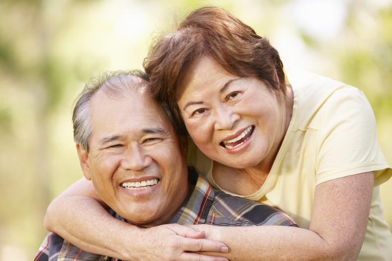 Older couple wearing affordable dentures