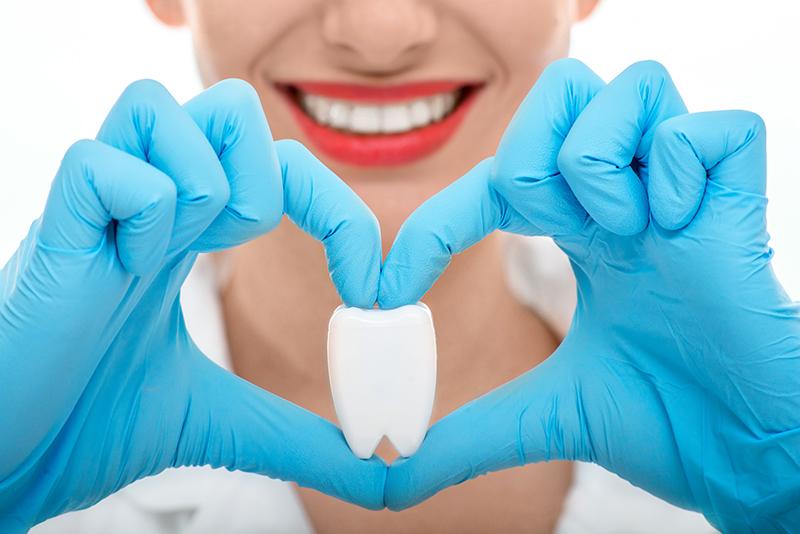dentist explaining link between heart disease and gum disease