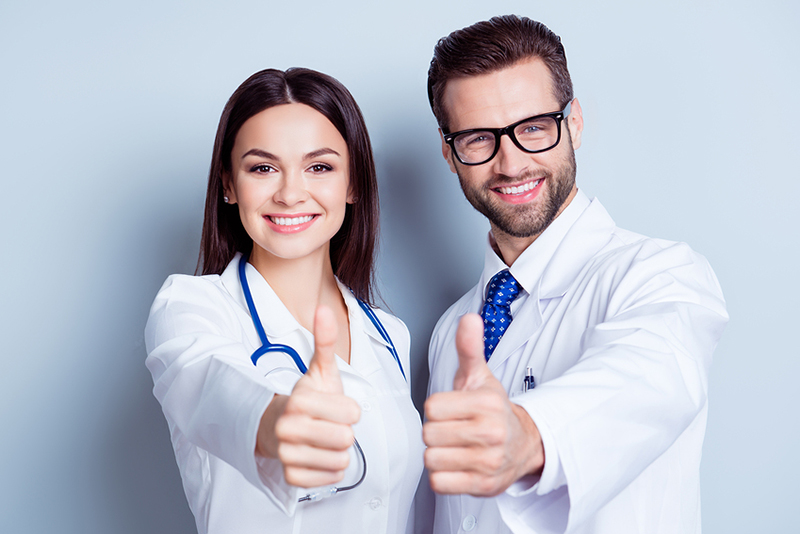 Happy doctor and dentist