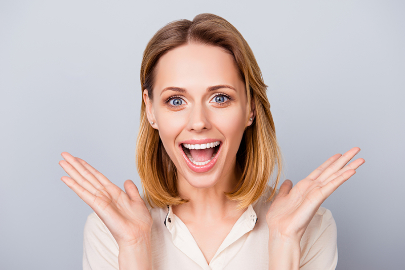 Happy Surprised Young Lady Laughing