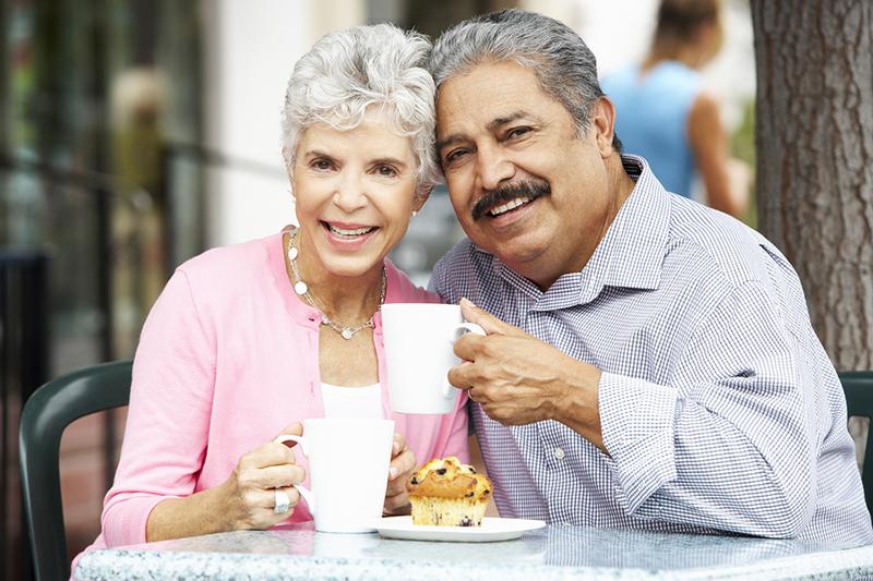Senior Couple Enjoying Snack Outside