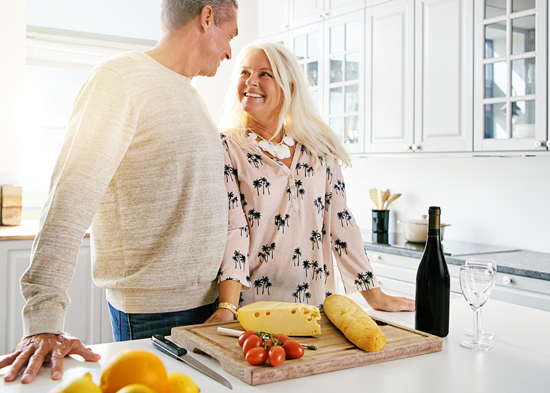 Couple discussing how cheese prevents tooth decay