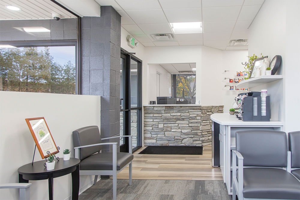 Reception area with front desk, waiting chairs, and coffee bar.