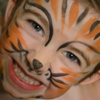 Corky Magic painted little boy's face like a tiger