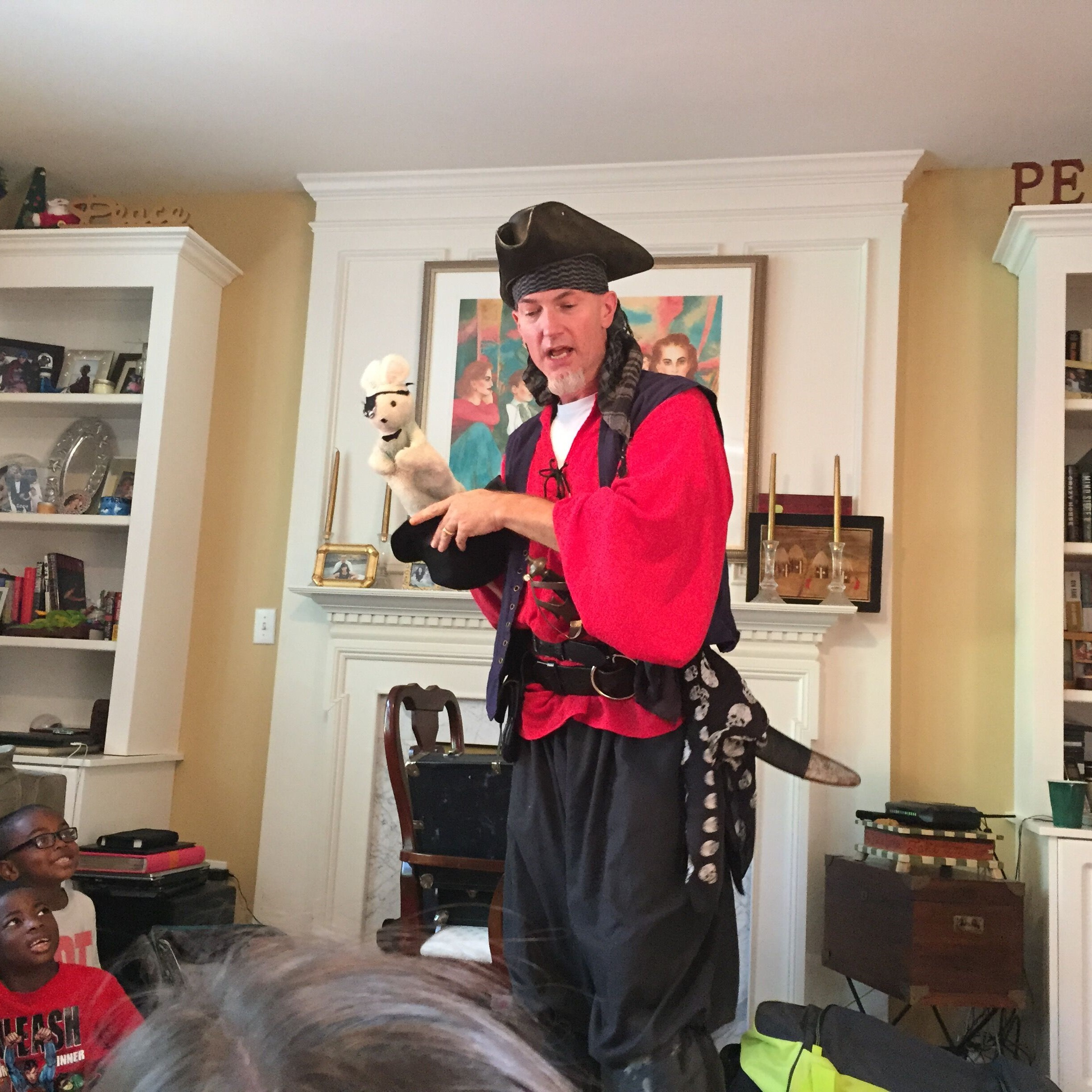 Pirate doing magic tricks at birthday party