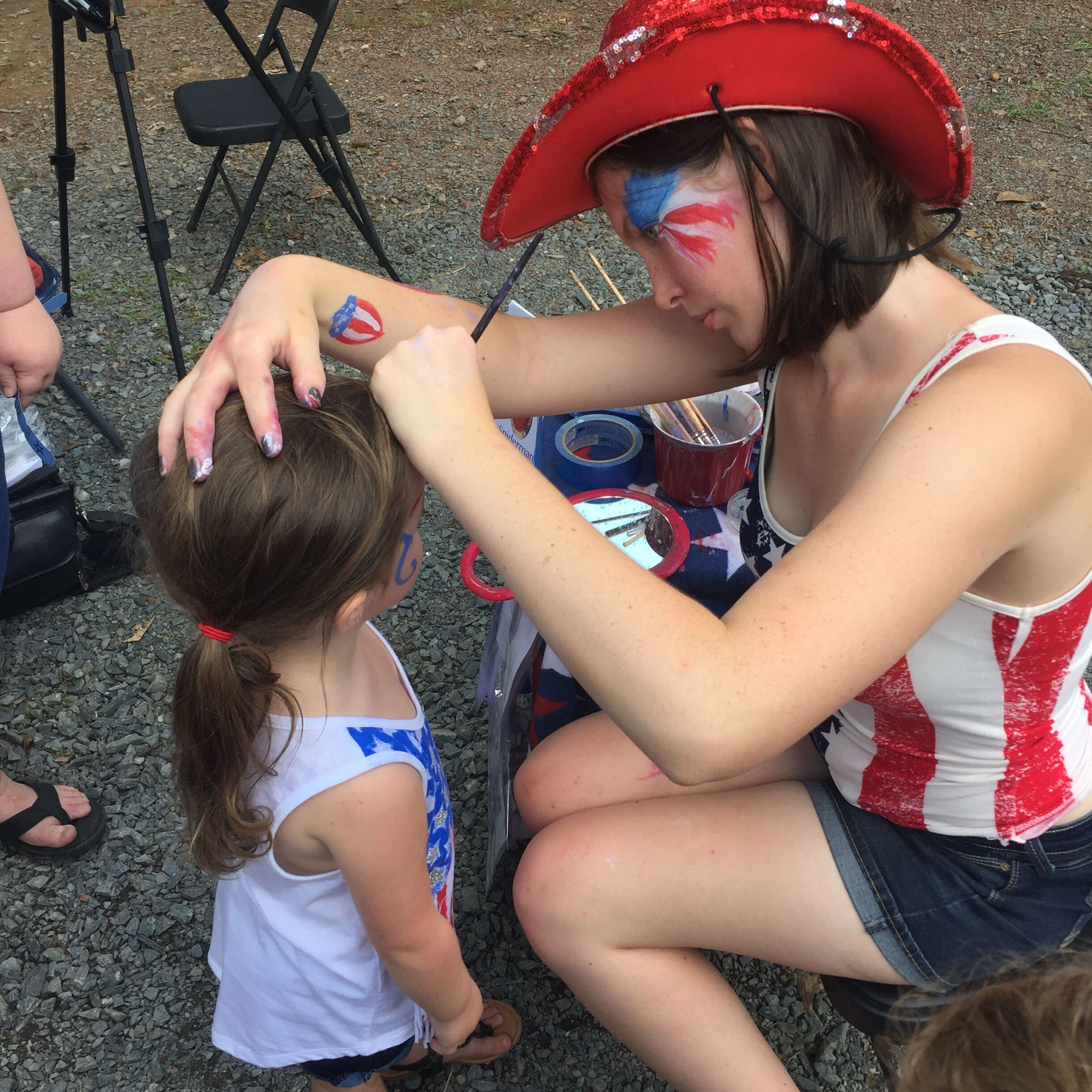 Daisy painting faces for Corky Magic event