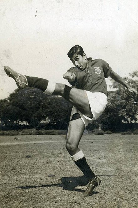 A black and white image of Pradip Kumar Banerjee, India's footballer of the 20th century by FIFA showcasing a football shot with his left leg