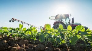 tractor-spraying-herbices-on-soy-bean-field
