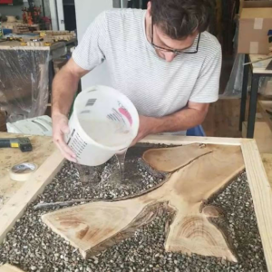 Woodworking with resin over pebbles will create an amazing look!