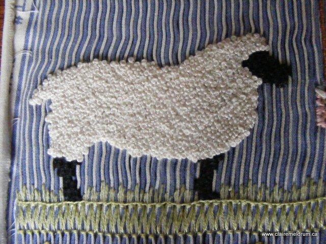 Smocked sheep detail
