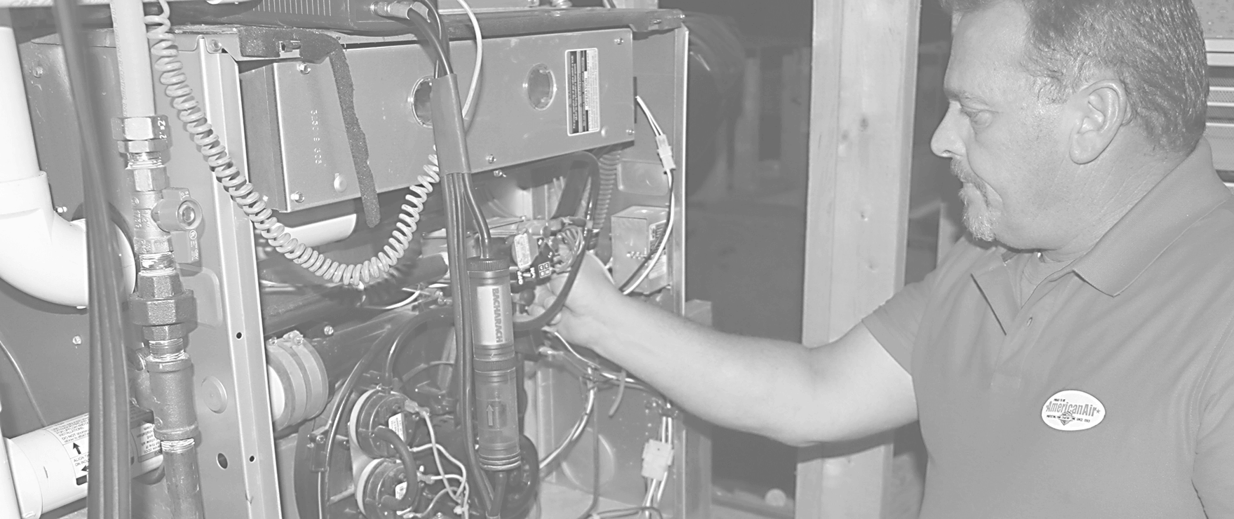 american air hvac technician checking home system