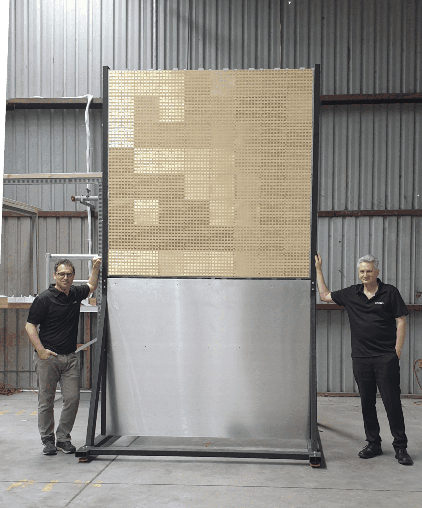 Greg Kushnir, Founder and CEO, and Dr Ray Simpkin, Chief Science Officer, standing next to the prototype system transmitting antenna
