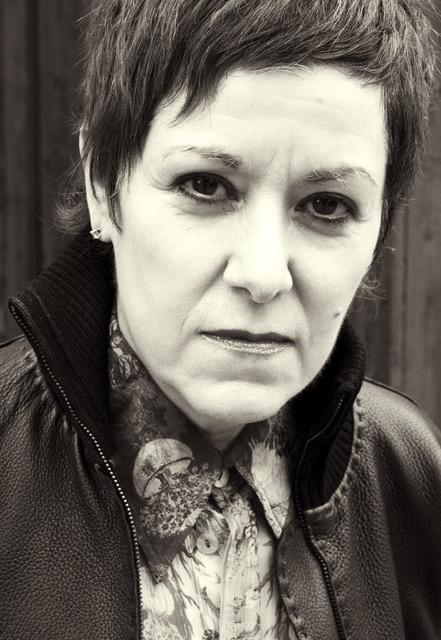 Black and white photo of Latinx poet