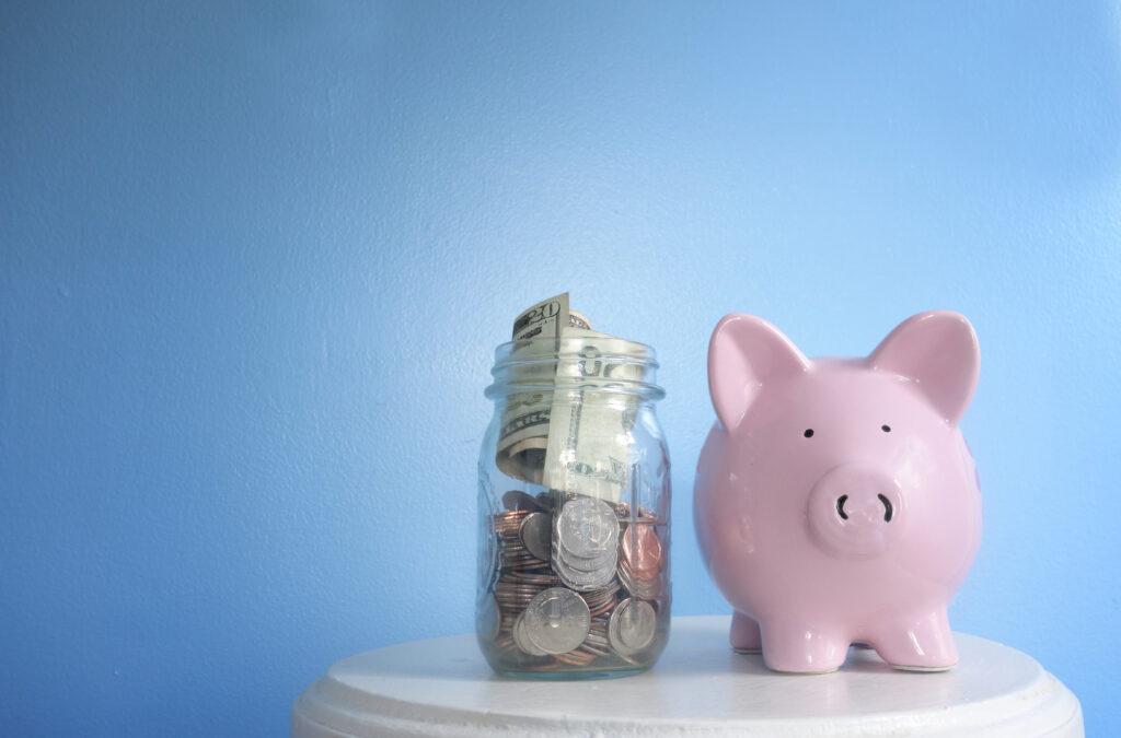 piggy bank and jar of money
