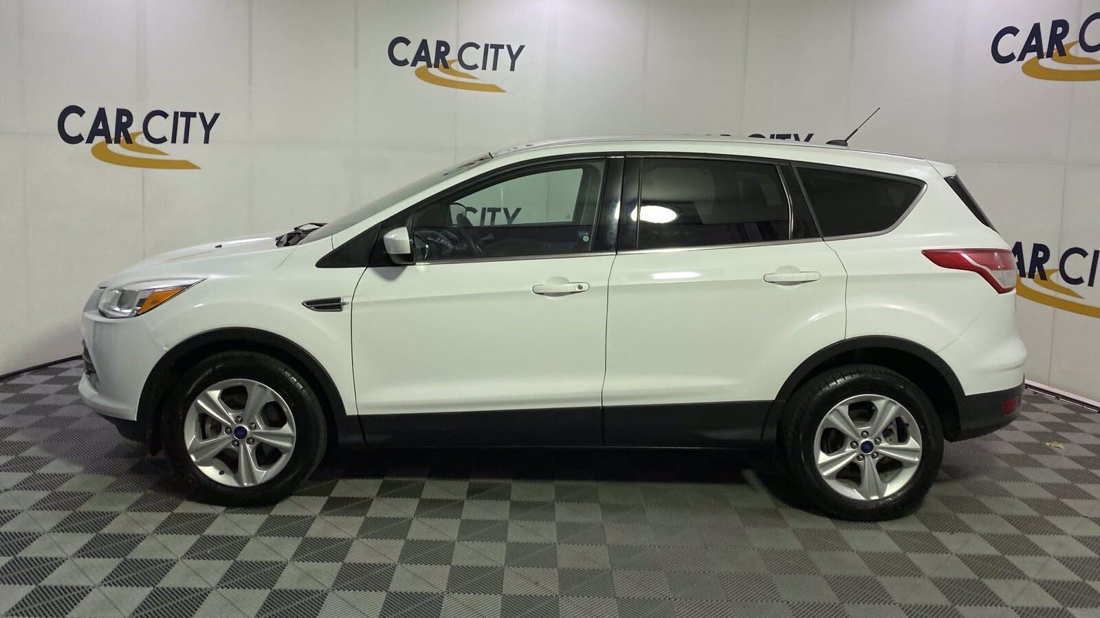 2016 Ford Escape SE. A great used car for recent grads.