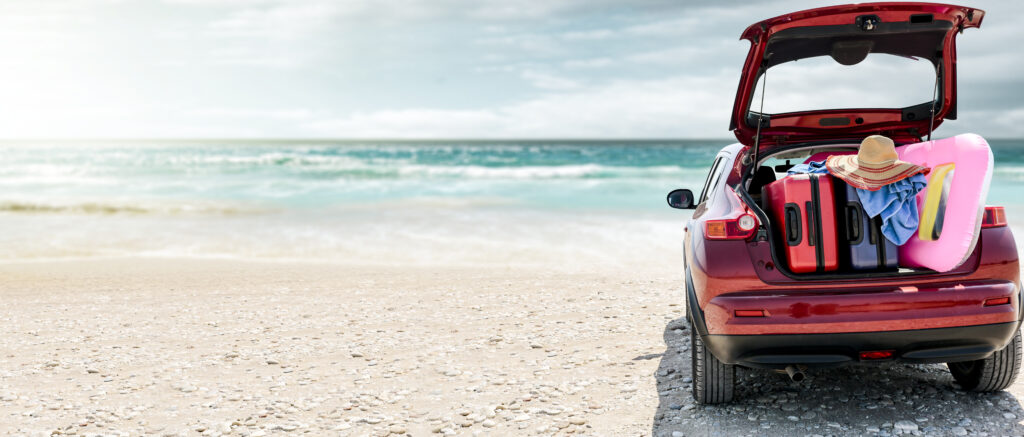 Vehicle parked on the beach. Car City has quality used vehicles for your summer road trip up north.