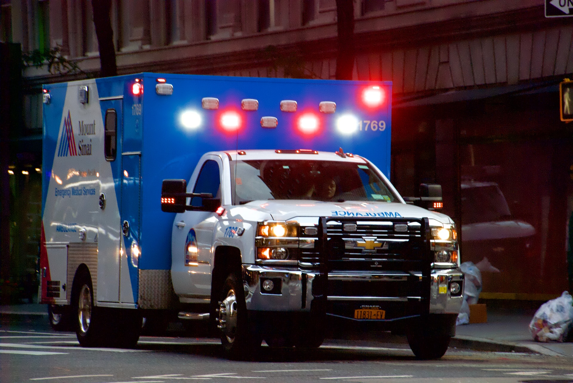 Photo of ambulance with its emergency lights on