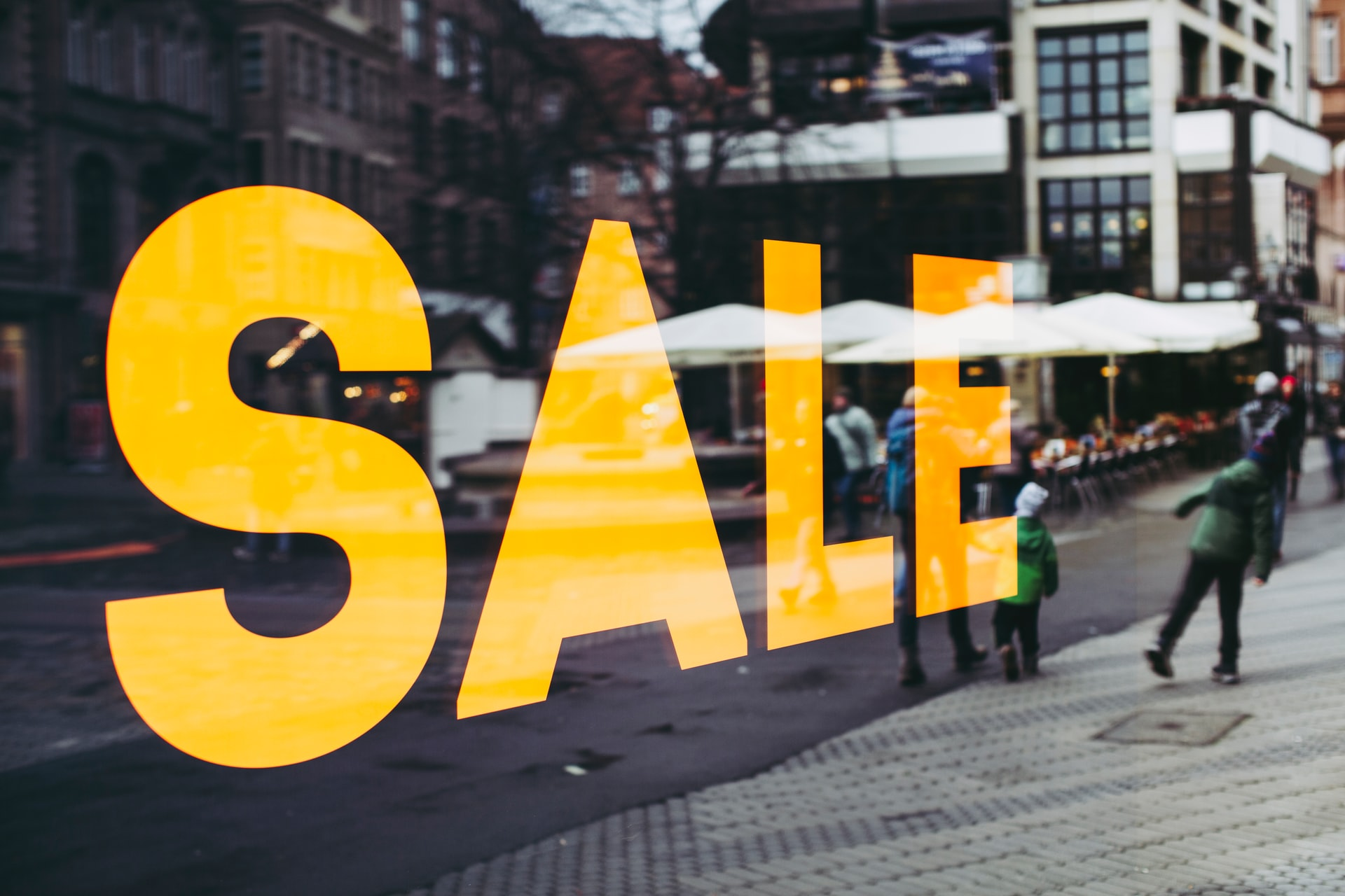 Photo of store window showing SALE sign