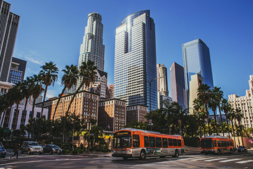 Photo of downtown Los Angeles buildings and palm trees