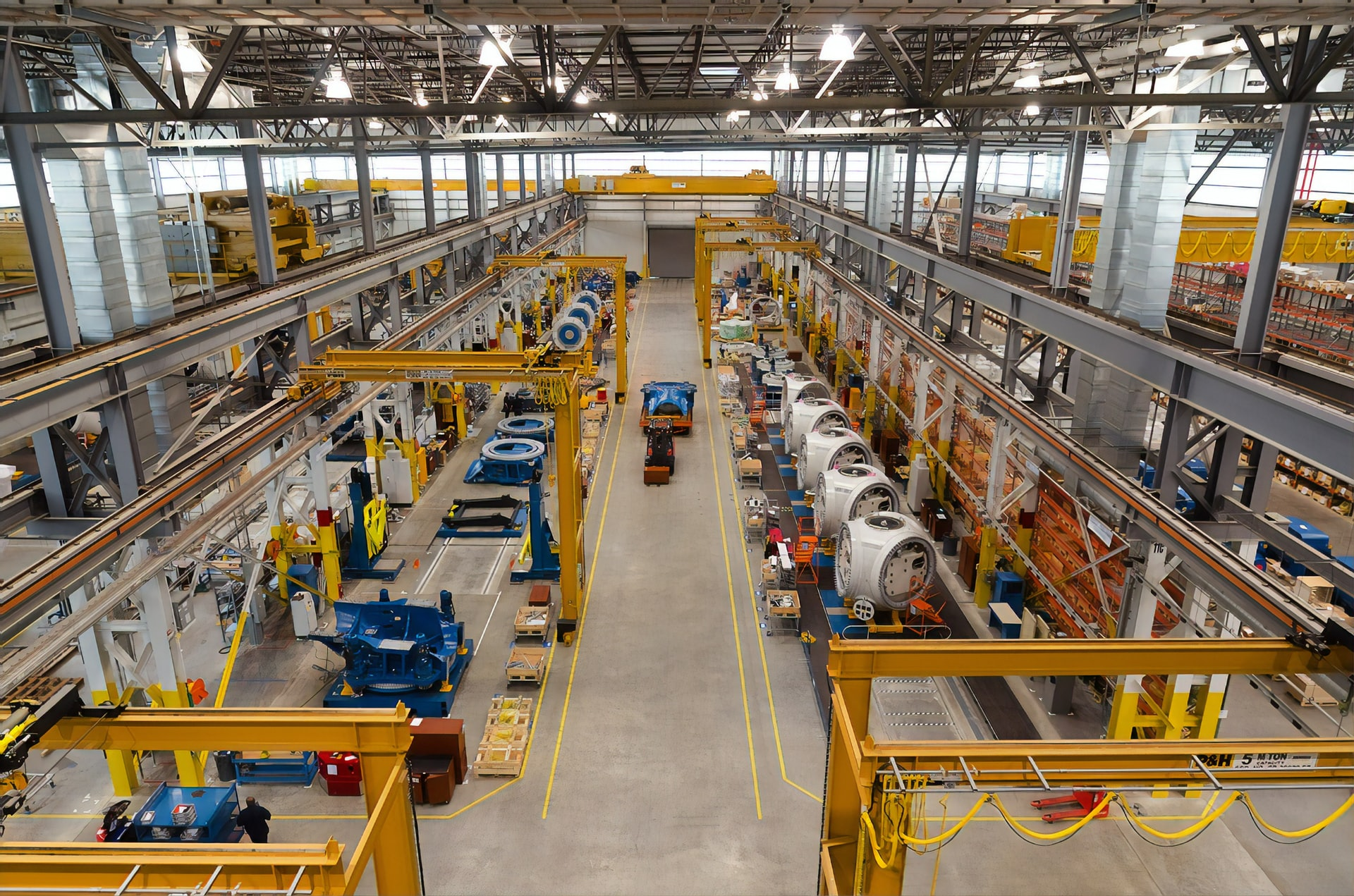 Photo of a large, multistory manufacturing plant taken from the ceiling