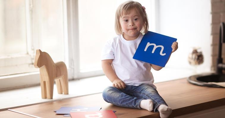 Girl learning alphabet