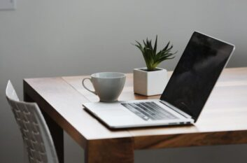 Computer and Coffee Cup