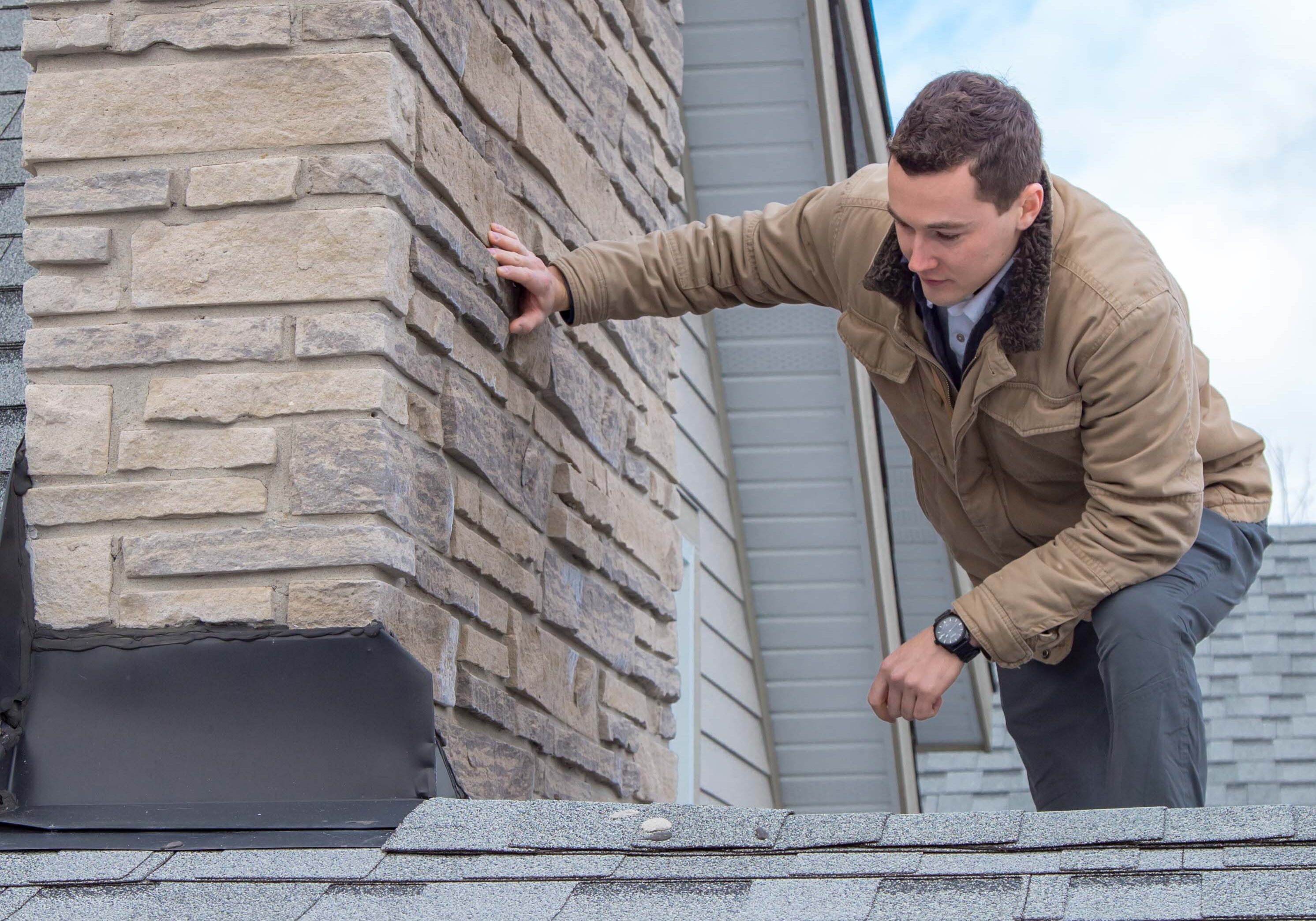 A professional performing a home inspection in Brantford