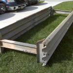 An awesome feeder: versatile, easily moved around, super tough, resists rust, and built out of super-solid twenty inch ( Thrie-Beam ) guardrail and those farm-strong 6 inch I-beam posts.