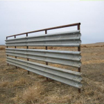 Here's a quickly built windbreak with thrie-beam 20 inch wide guardrail panel.