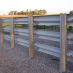 Favorite shot of posts and rail installation. Solid, galvanized, permanent, worry-free – this fence will just stand there and do its job – rain, sleet, snow or shine for decades on end of service. Solid, clean and straight.